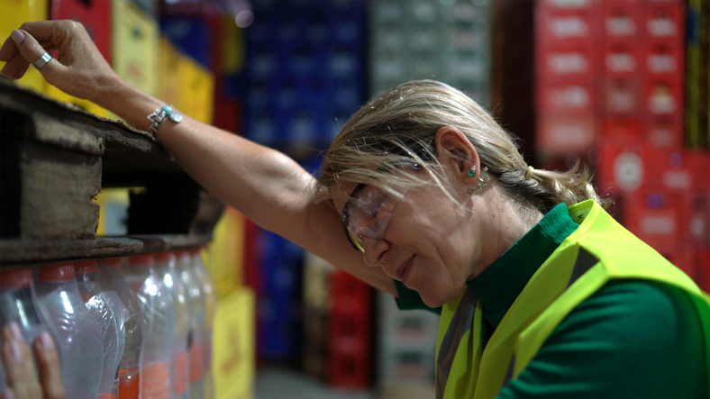 Exhausted employee at over-heated warehouse